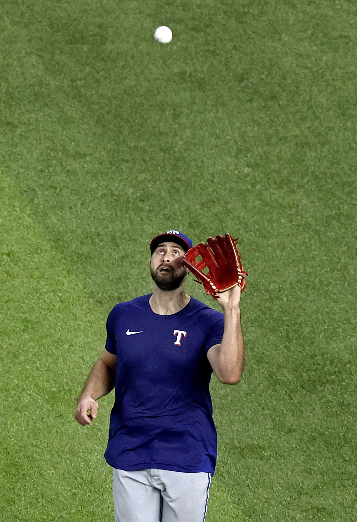 Texas Rangers outfielder Joey Gallo fields a fly ball during Summer Camp practice inside Globe Life Field in Arlington, Texas, Friday, July 10, 2020. Gallo made his first appearance after clearing the COVID-19 intake process but did not participate in the simulated game. (Tom Fox/The Dallas Morning News)