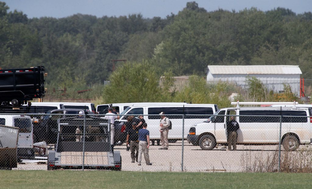 Agents from Homeland Invistigation Unit and other agencies inside Load Trail  after Immigration and Customs Enforcement raided the trailer manufacturer in Sumner, Texas on Aug. 28, 2018.