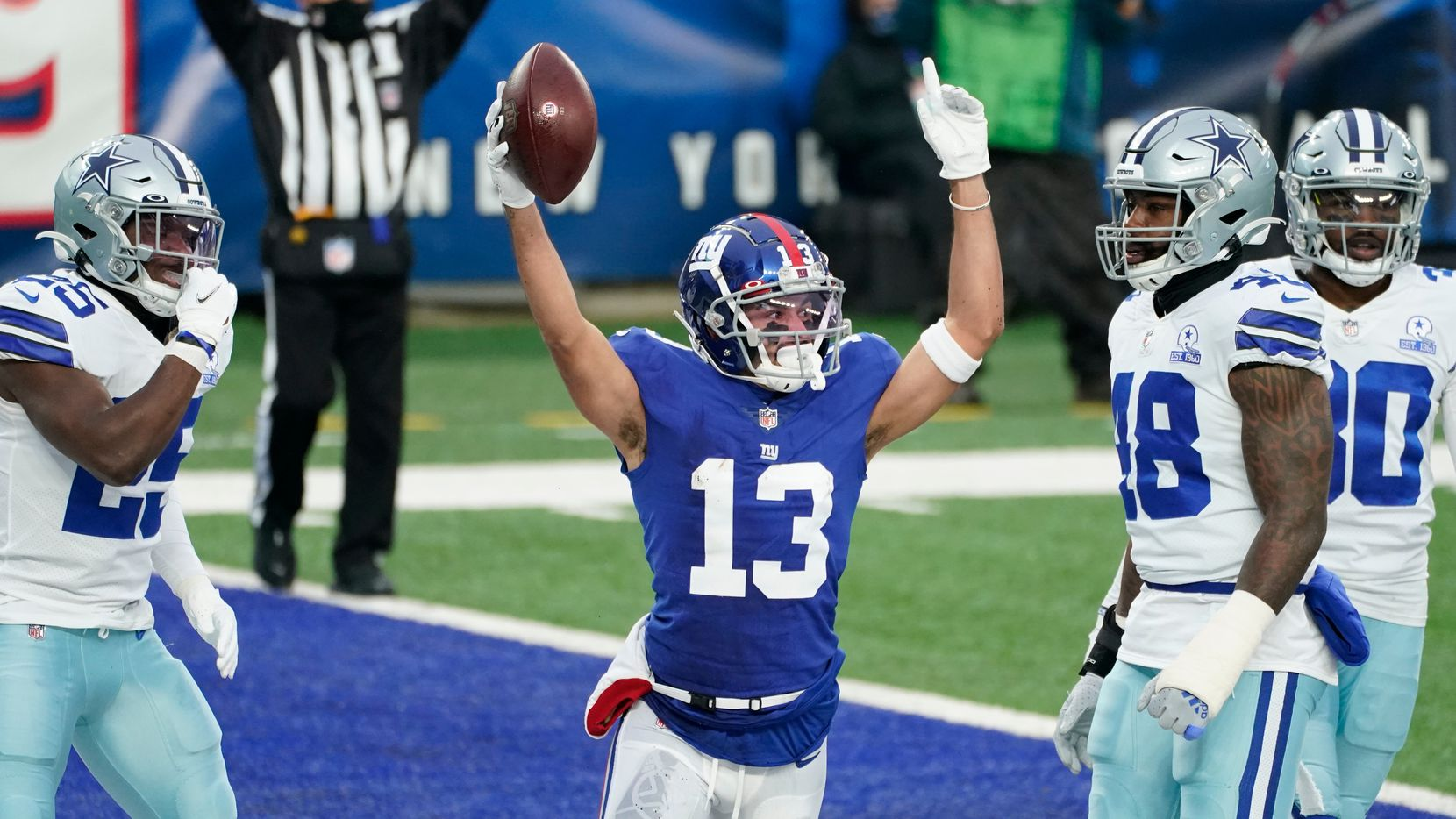 New York Giants' Dante Pettis, center, celebrates his touchdown during the first half of an NFL football game against the Dallas Cowboys, Sunday, Jan. 3, 2021, in East Rutherford, N.J. (AP Photo/Corey Sipkin)