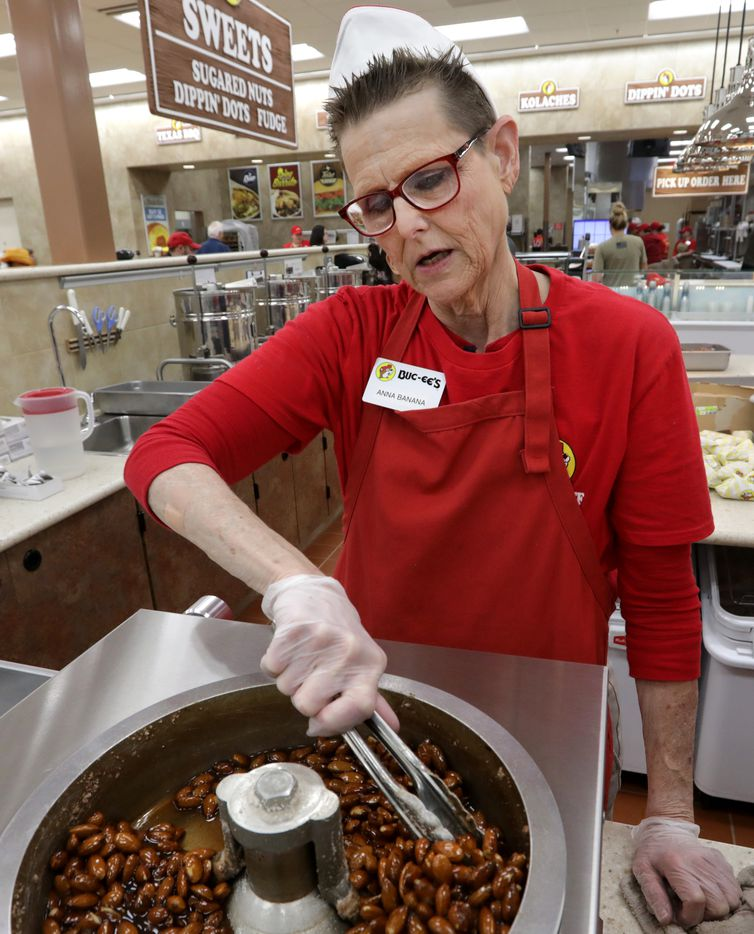 Anna Rowley mixes fresh roasted nuts at the new Buc-ee's in Melissa, TX, on Apr. 29, 2019.