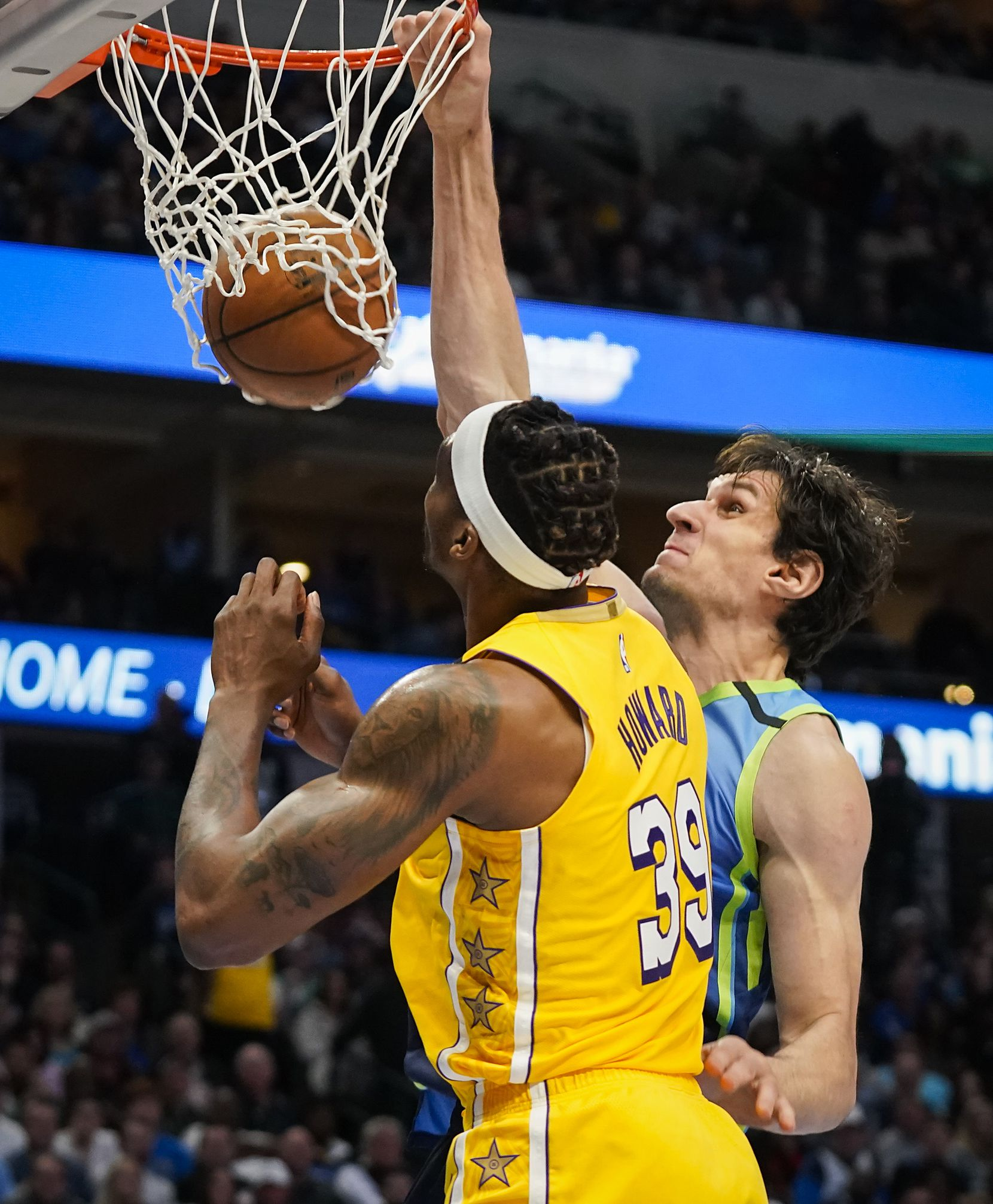Dallas Mavericks center Boban Marjanovic (51) dunks the ball as Los Angeles Lakers center Dwight Howard (39) defends during the first half of an NBA basketball game at American Airlines Center on Friday, Jan. 10, 2020, in Dallas.