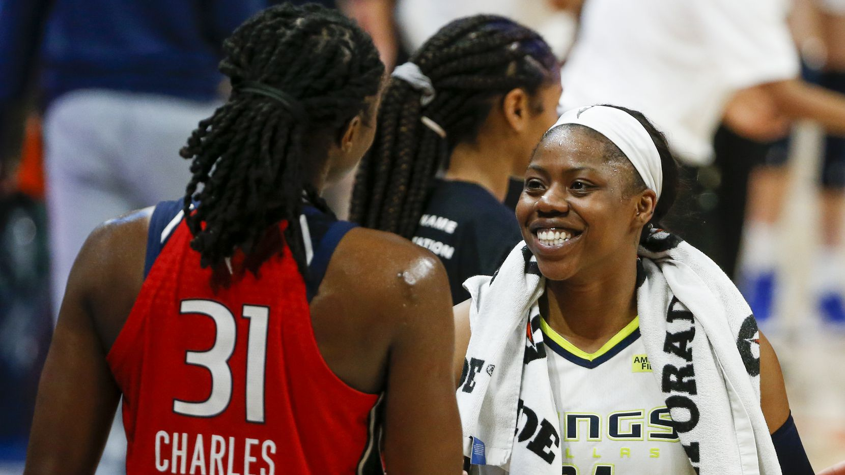 Dallas Wings guard Arike Ogunbowale (24) greets Washington Mystics center Tina Charles (31) after an 85-74 win over the Mystics at College Park Center on Saturday, June 26, 2021, in Arlington. (Elias Valverde II/The Dallas Morning News)