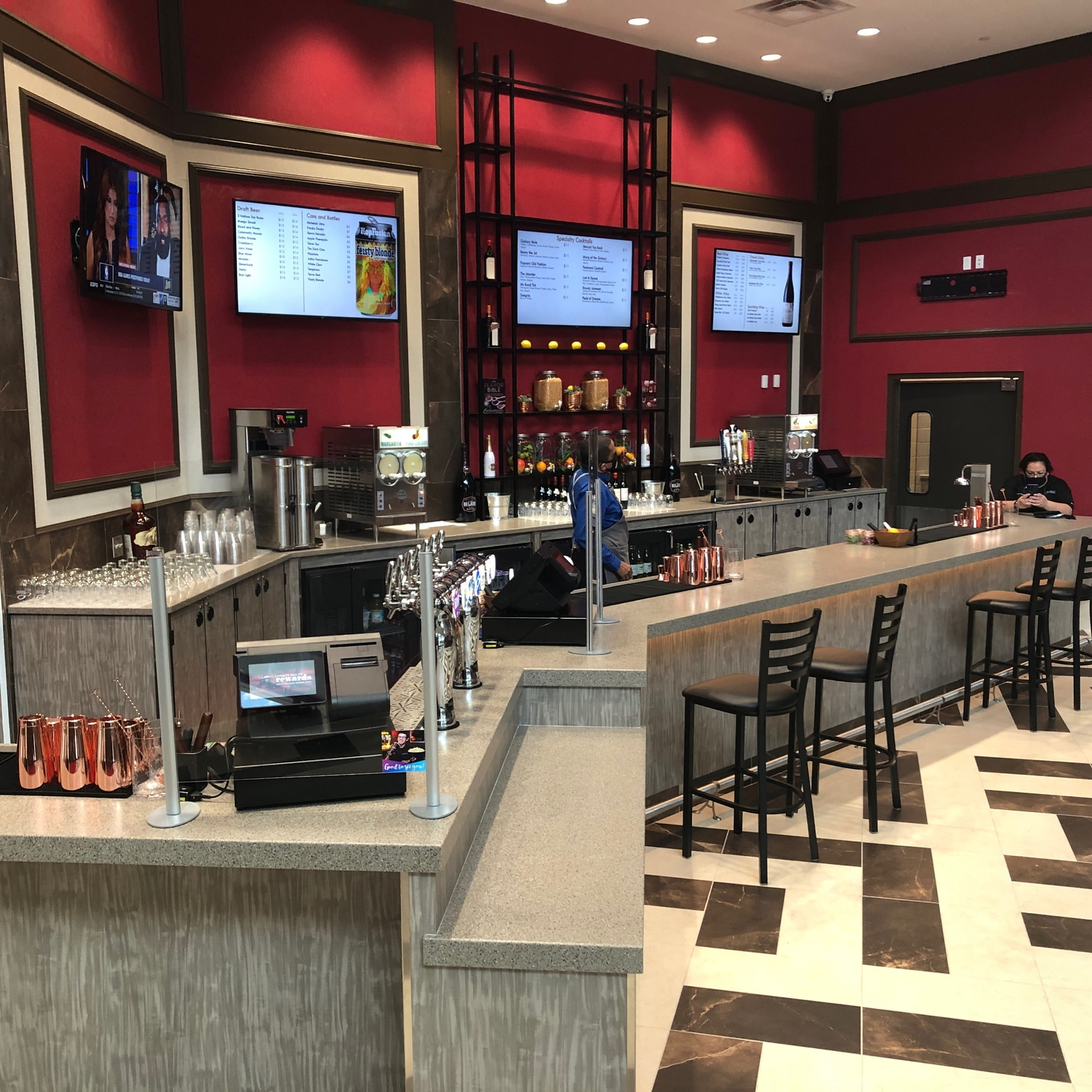 The new theater features a bar serving cocktails, beer and wine.