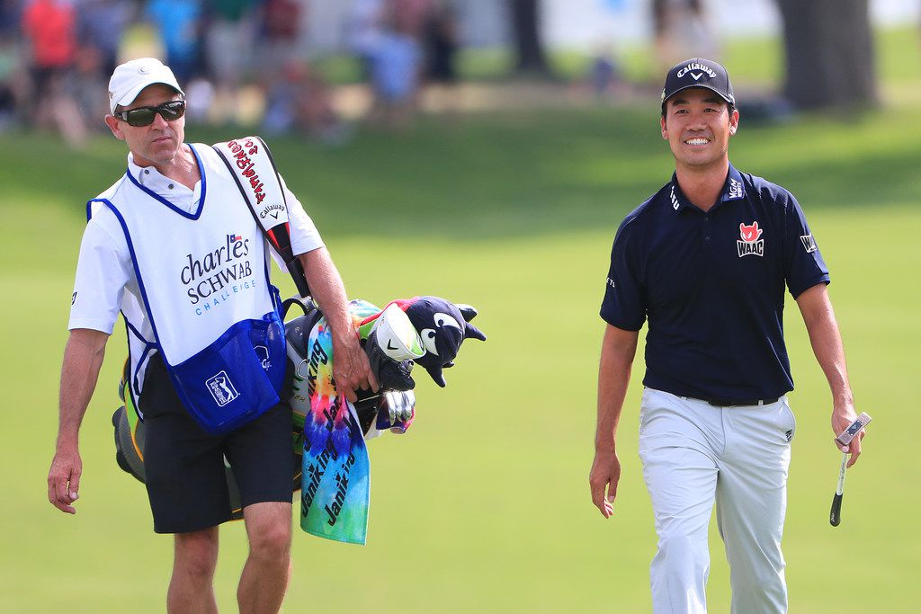 FORT WORTH, TEXAS - MAY 26:  Kevin Na of the United States and caddie, Kenny Harms, walk up the 18th fairway during the final round of the Charles Schwab Challenge at Colonial Country Club on May 26, 2019 in Fort Worth, Texas. (Photo by Tom Pennington/Getty Images)