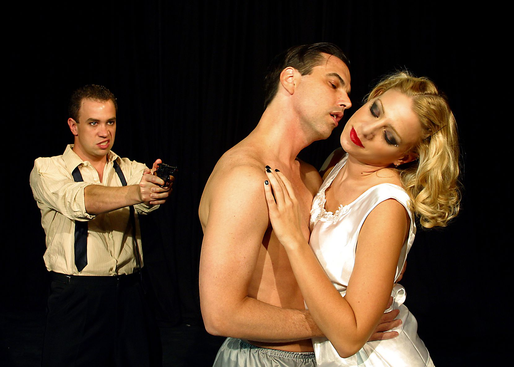 "James Wesley (left), Donald Fowler and Stacey Oristano in ""The Wild Party"" by Uptown Theatre."
