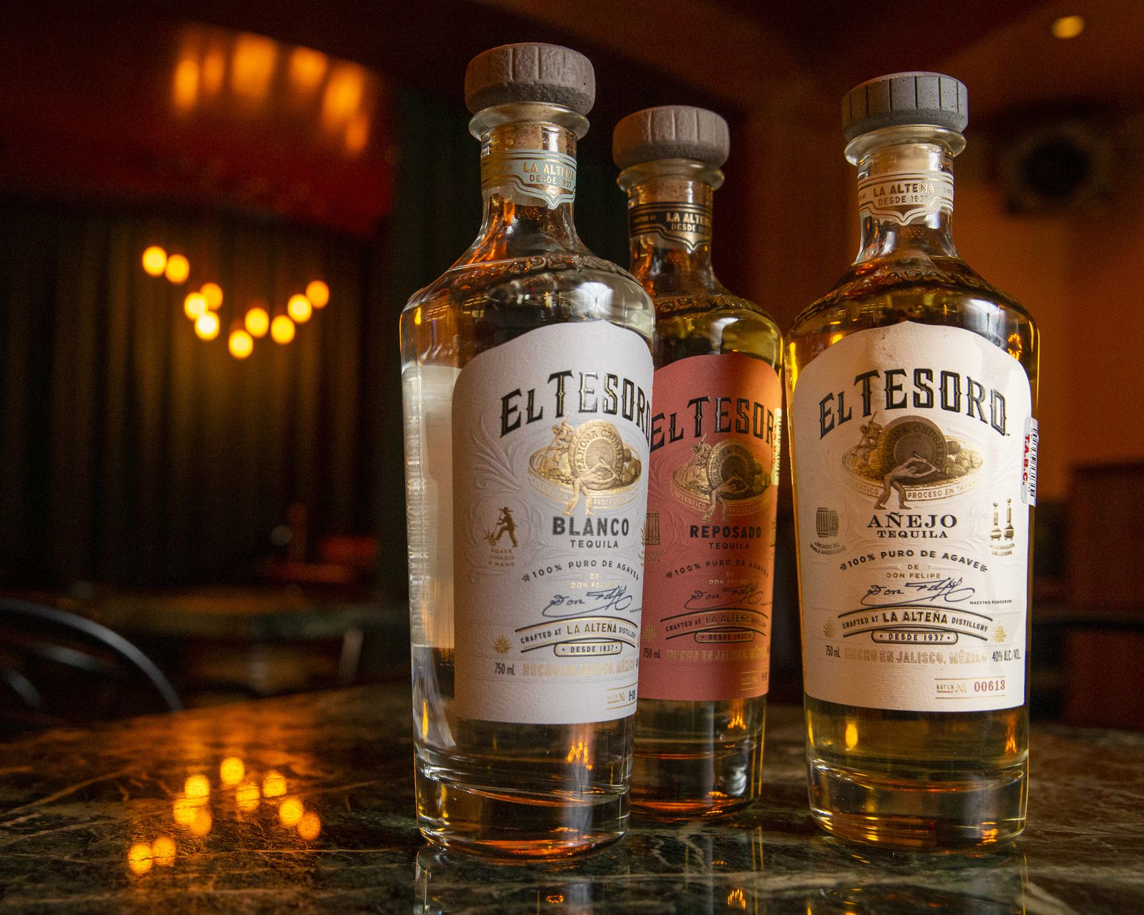 A trio of El Tesoro tequila bottles are photographed at the Midnight Rambler located inside the Joule Hotel in downtown Dallas.