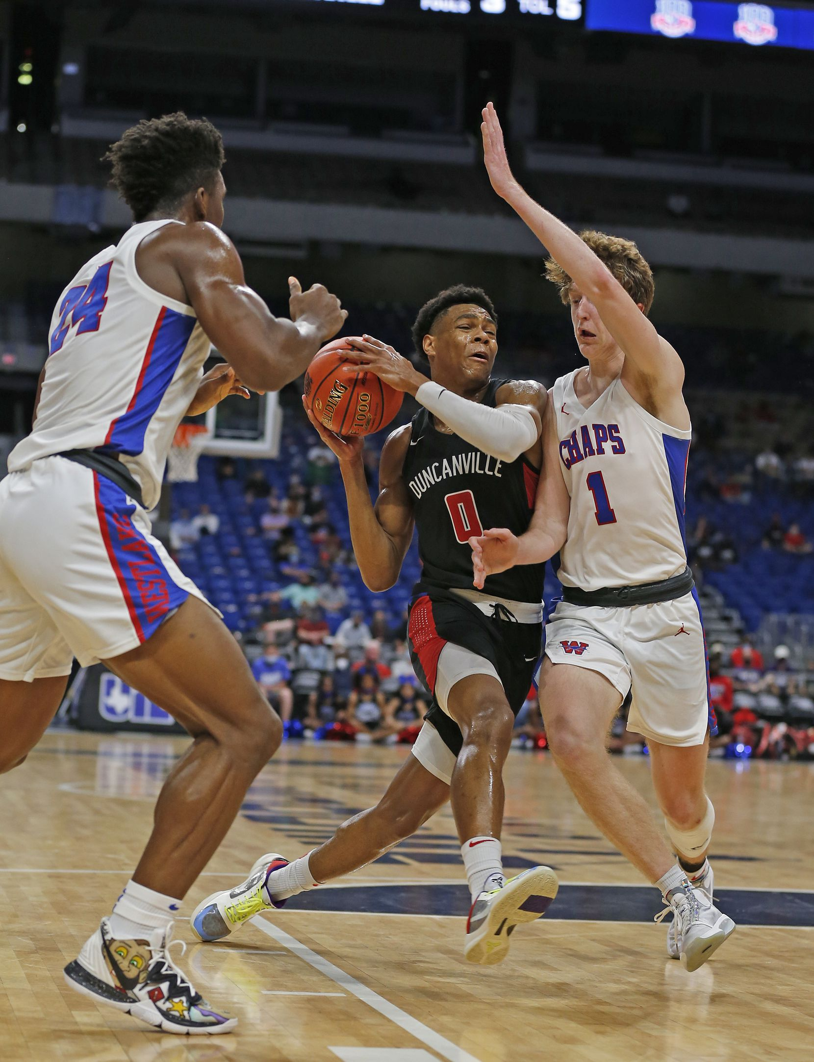 Duncanville Zhuric Phelps #0 drives on Westlake Cade Mankle #1. UIL boys Class 6A basketball state championship game between Duncanville and Austin Westlake on Saturday, March 13, 2021 at the Alamodome.