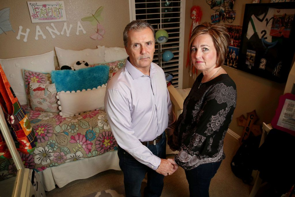 Tim and Raina Clark pose for a photograph at their home in Rockwall, Texas on Dec. 7, 2016. Their daughter Hanna Clark, whose bedroom they are posing in, committed suicide in 2013 at the age of 15. (Rose Baca/The Dallas Morning News)