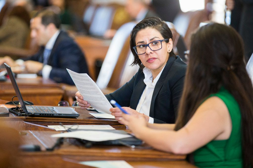 Rep. Jessica González, D-Dallas, talks with Rep. Mary González, D-El Paso, on the second day of the 86th Texas Legislature on Wednesday  in Austin. Both representatives are members of the state Legislature's first LGBTQ caucus.
