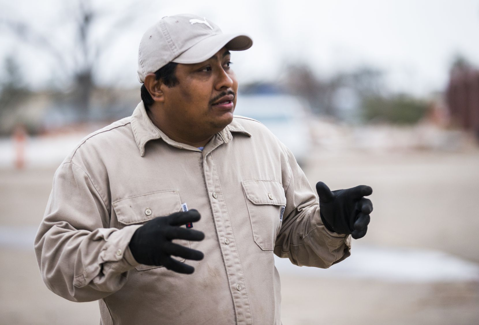 Member Jesus Gonzalez talks about the cleanup efforts at Primera Iglesia Bautista Mexicana on Tuesday in Dallas. The church was destroyed by a tornado last month.