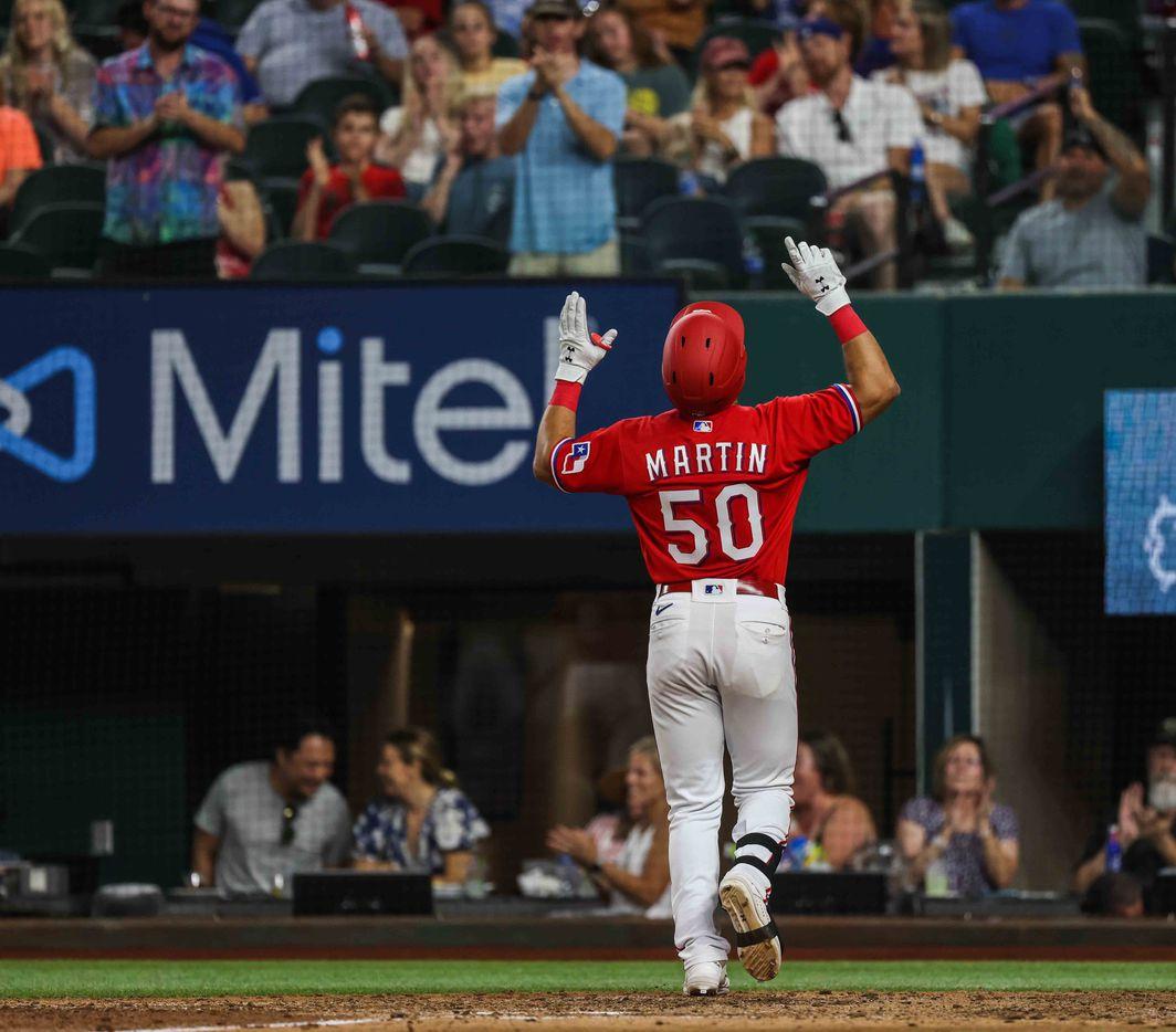 Texas Rangers Jason Martin (50) celebrates his home run in the seventh inning at Globe Life Field in Arlington, Texas, Friday, July 30, 2021. Seattle 8, Rangers 5. (Lola Gomez/The Dallas Morning News)