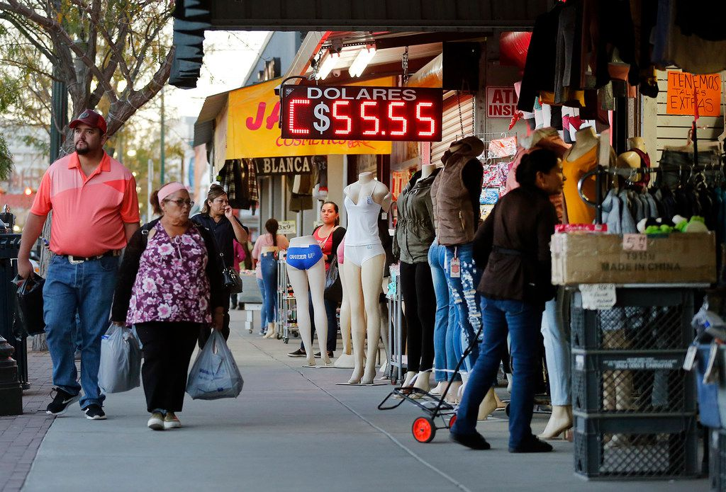 People shop along S. El Paso Street in downtown El Paso, Texas, Wednesday, November 7, 2018. The Paseo de Las Luces is a $6.4 million investment in El Paso's downtown shopping district. It has long been the gateway to Juarez, Mexico leading to the bridge and its border crossing. They hope to do the same on the other side of the Rio Grande River enhancing the area between the Santa Fe International Bridge and San Jacinto Plaza.