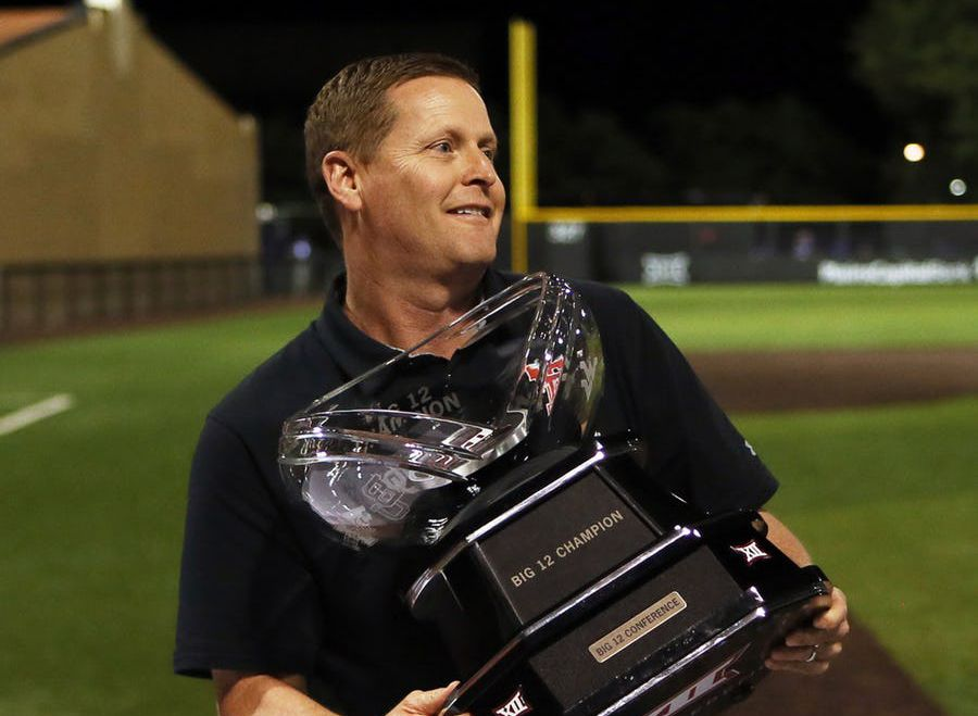 Texas Tech athletic director Kirby Hocutt holds the Big 12 Conference championship trophy after the team's NCAA college baseball game against TCU on Saturday, May 18, 2019, in Lubbock, Texas. (Sam Grenadier/Lubbock Avalanche-Journal via AP)
