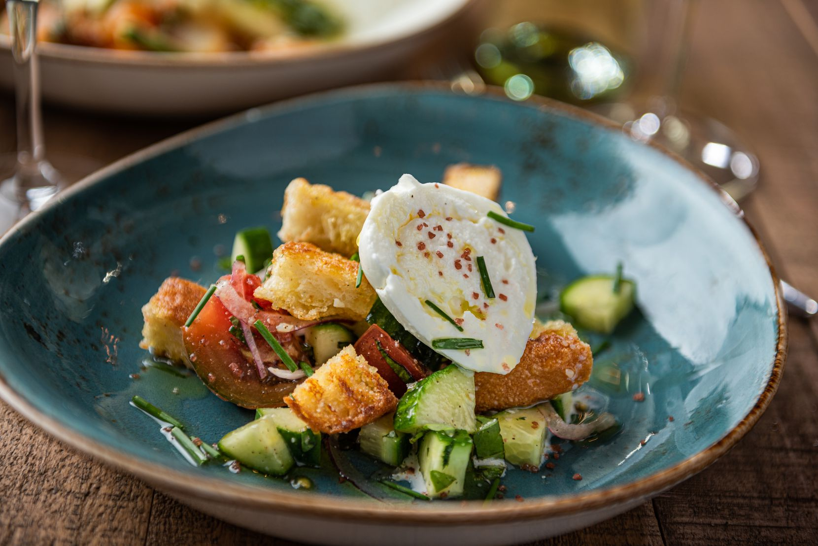 Cru Food And Wine Bar's brunch and dinner menus for Father's Day include heirloom tomato and burrata salad.