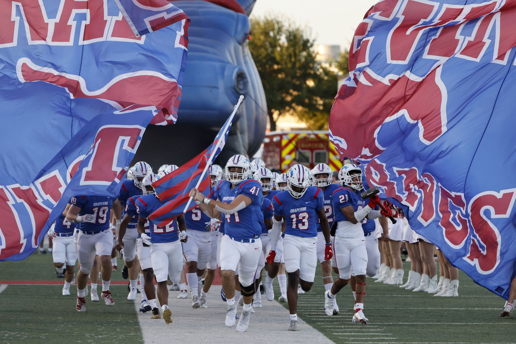 Grapevine players run onto the field prior to playing Colleyville Heritage during the first half of their high school football game in Grapevine, Texas on Aug. 27, 2021. (Michael Ainsworth/Special Contributor)