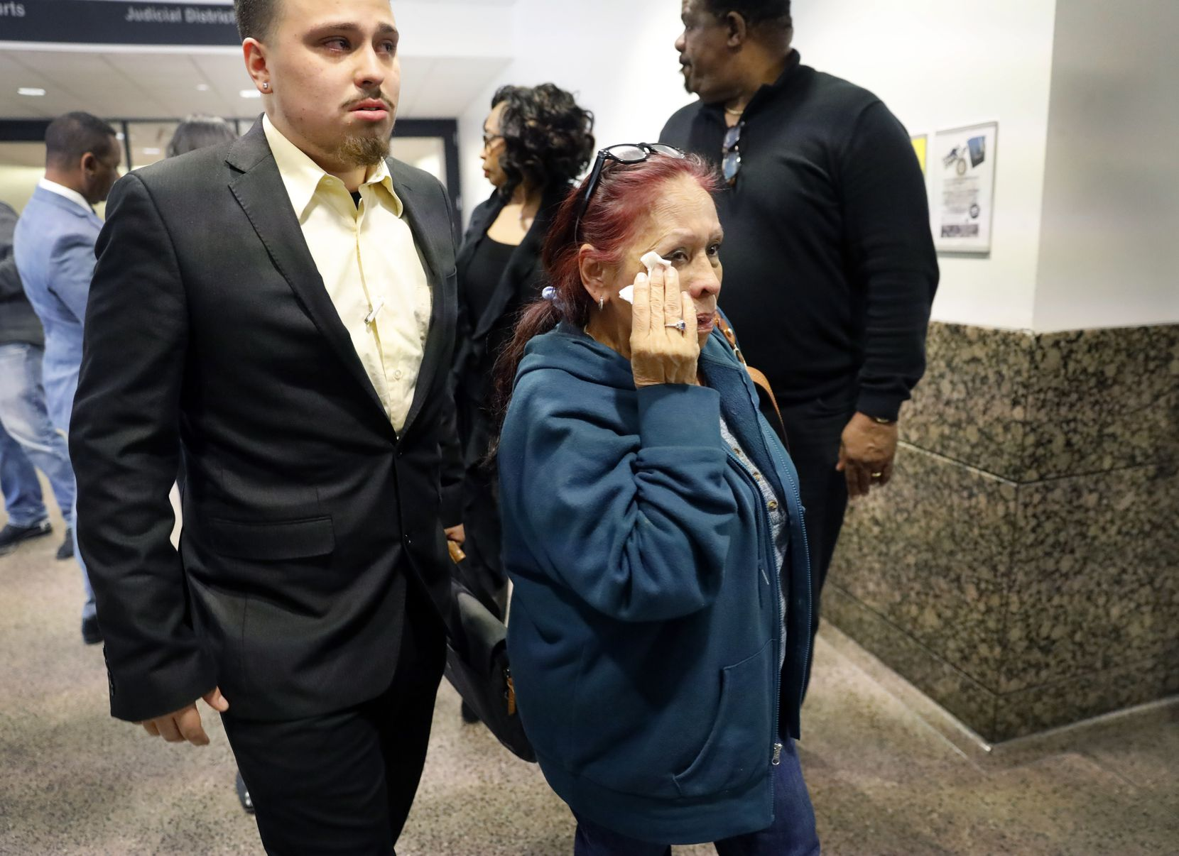 Christina Saucedo (right), grandmother of Genevive Dawes, and cousin Joseph Vickery (left) leave the 292nd District Court at the Frank Crowley Courts Building in Dallas after Hess was found not guilty in Dawes' death.
