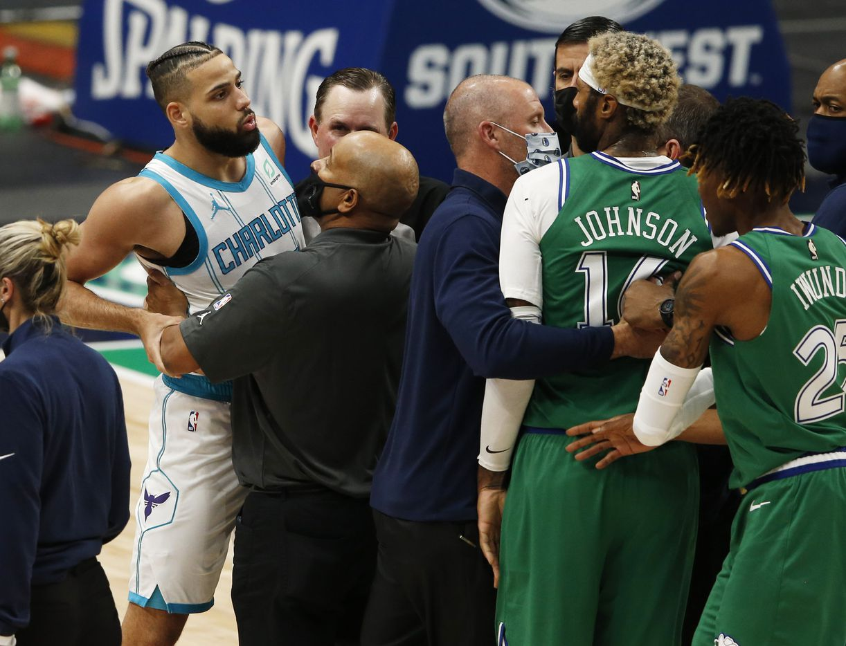 Coaches attempt to keep Charlotte Hornets forward Cody Martin (11) and Dallas Mavericks forward James Johnson (16) away from each other during an altercation that got both players ejected from the game during the fourth quarter of play in the home opener at American Airlines Center on Wednesday, December 30, 2020 in Dallas. The Mavericks lost to the Hornets 118-99. (Vernon Bryant/The Dallas Morning News)