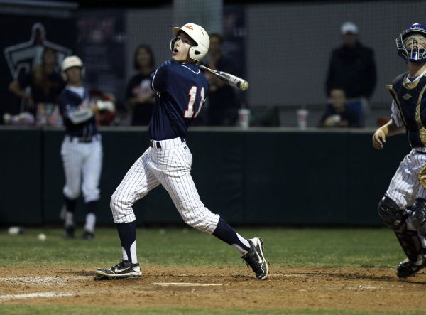 Frisco Wakeland's Ryan Perry (11) at bat against Frisco Centennial during a high school baseball game Frisco Centennial  in Frisco on Friday, April 13, 2012.
