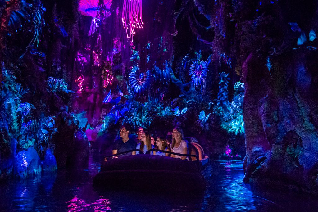 The Na'vi River Journey floats past animated creatures, plants and a shaman at Pandora — The World of Avatar.