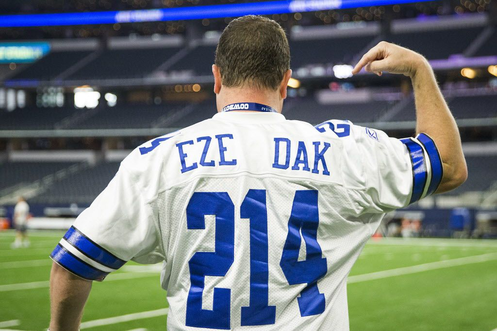Dallas Cowboys fan Brad Holden wears a shirt with both the names and numbers of running back Ezekiel Elliott (21) and quarterback Dak Prescott (4) before an NFL football game against the Chicago Bears at AT&T Stadium on Sunday, Sept. 25, 2016, in Arlington. (Smiley N. Pool/The Dallas Morning News)