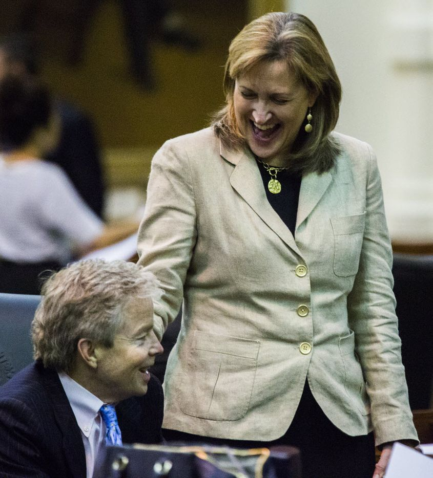 Sen. Konni Burton, R-Colleyville, and Sen. Don Huffines, R-Dallas, shared a laugh during the final days of the 84th Texas Legislature in 2015. The two appeared headed toward defeat during Tuesday's elections. (Ashley Landis/The Dallas Morning News)