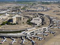 Aerial view of American Airlines aircraft at the gates of Terminal C (bottom) and Terminal A (top) at Dallas Fort Worth (DFW) International Airport on Thursday, April 16, 2020.