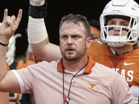 Head coach Tom Herman of the Texas Longhorns leads the team on to the field before the Orange-White Spring Game at Darrell K Royal-Texas Memorial Stadium on April 21, 2018 in Austin, Texas.