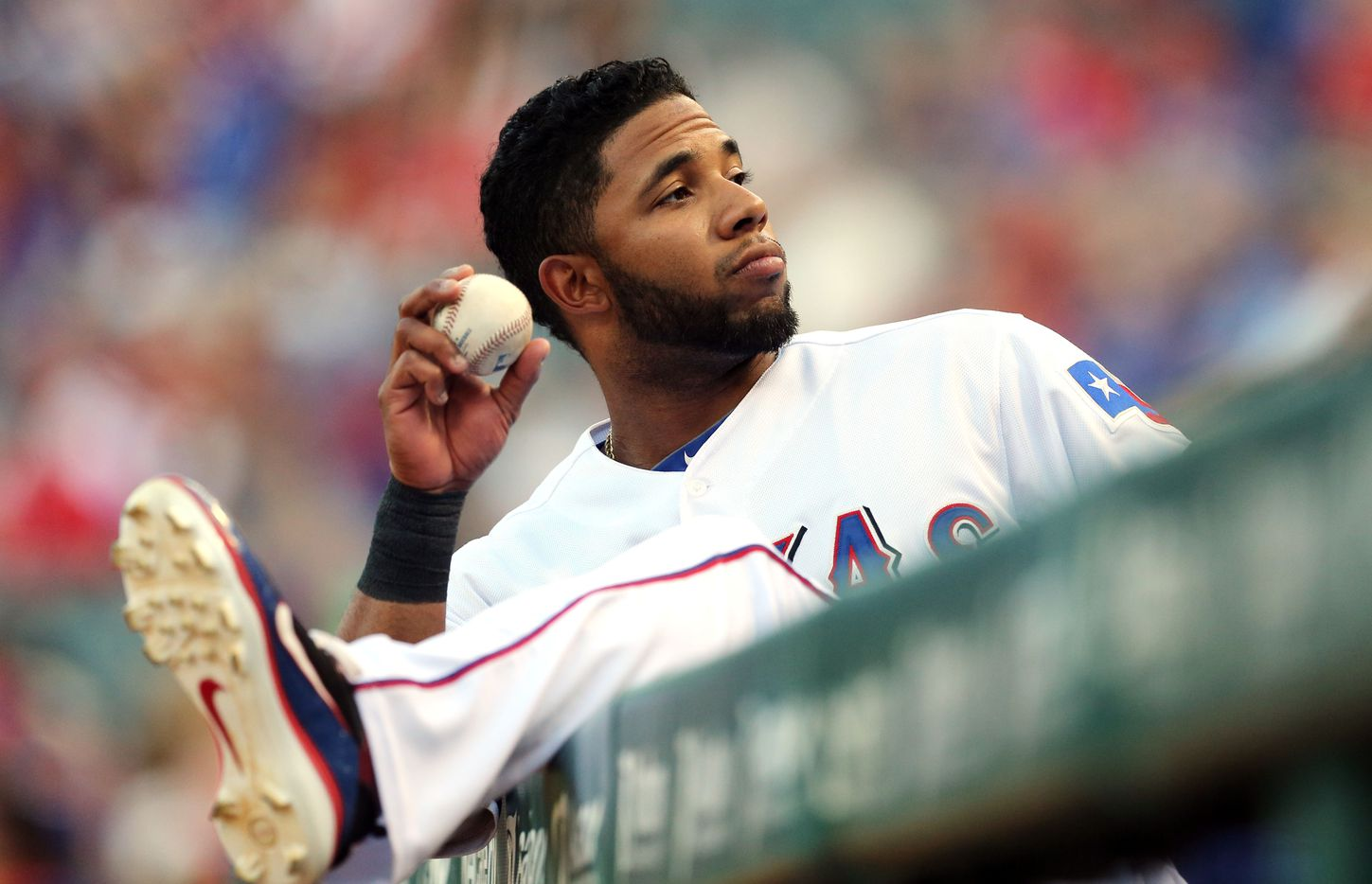 Texas shortstop Elvis Andrus throws a ball to a fan from the dugout before the Minnesota Twins vs. Texas Rangers major league baseball game at Rangers Ballpark in Arlington on Friday, August 24, 2012.  (Louis DeLuca/The Dallas Morning News) / mug - mugshot - headshot - portrait / 01232013xALDIA