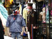 Jerry Purvis, owner of Dallas Vintage Shop in Plano, Texas, said his shop is in danger of going out of business as all the events that require costumes, gowns and hats are canceled due to COVID-19. The store pivoted to making fashionable masks but made just $15 on Monday.