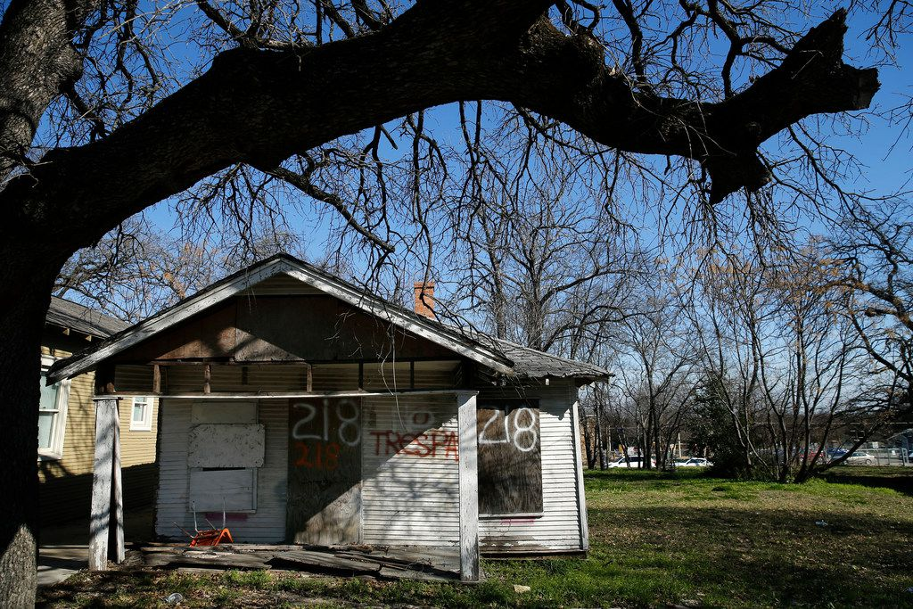 A house at Cliff and Church streets is boarded-up — a familiar sight throughout the Tenth Street Historic District