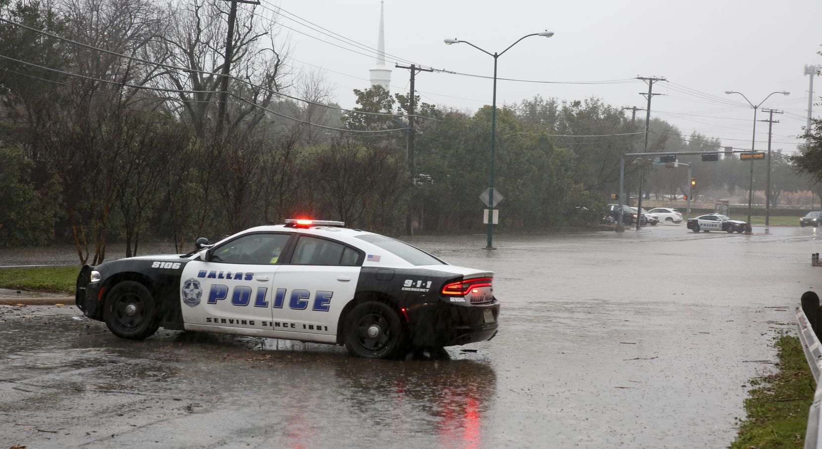 Dallas police shut down Hillcrest Road just south of Royal Lane after heavy rains caused street flooding in Dallas on Thursday, January 16, 2020.