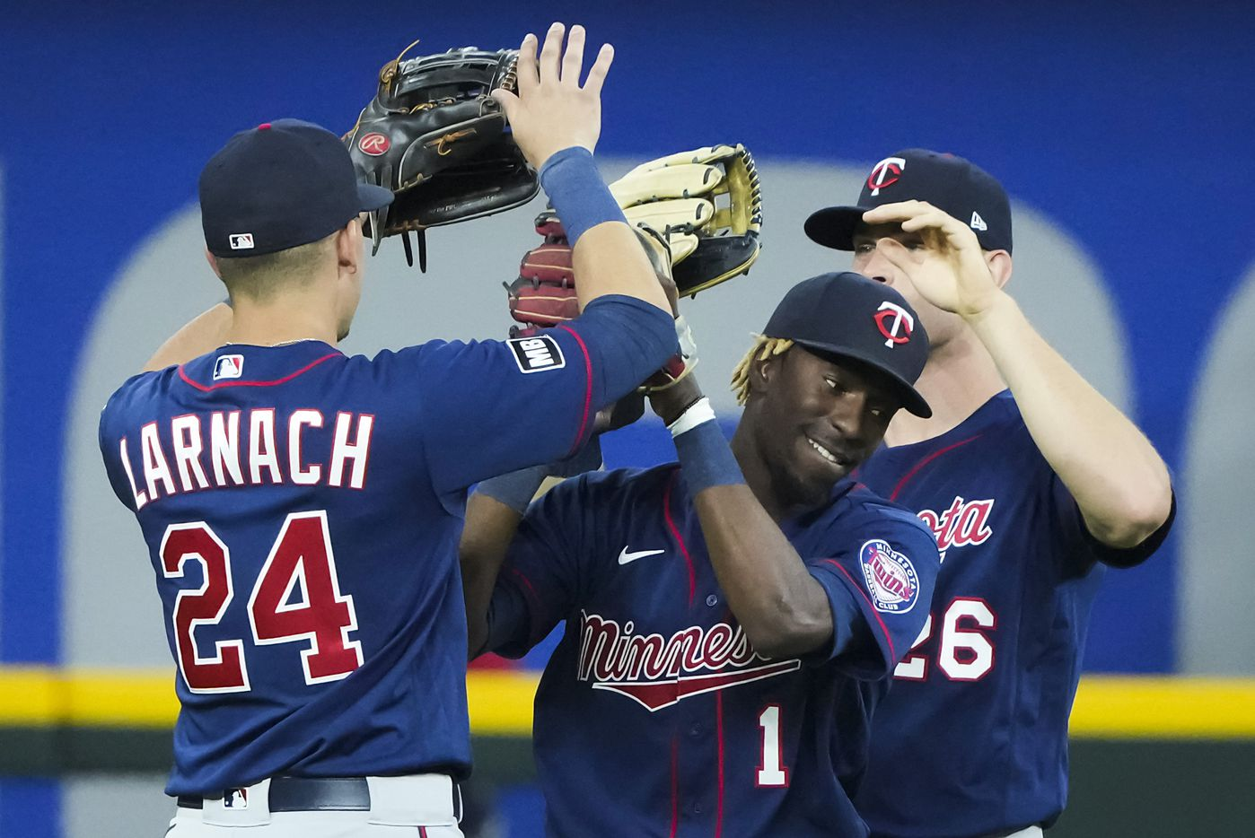 Minnesota Twins outfielders Nick Gordon (1), Trevor Larnach (24) and Max Kepler (26) celebrate after a victory over the Texas Rangers at Globe Life Field on Friday, June 18, 2021.