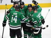 Dallas Stars right wing Alexander Radulov (47) is congratulated by teammates Dallas Stars center Joe Pavelski (16), Dallas Stars left wing Jamie Benn (14), Dallas Stars defenseman John Klingberg (3), and Dallas Stars left wing Roope Hintz (24) after Radulov scored a goal in a game against the Nashville Predators during the second period of play in the Stars home opener at American Airlines Center on Friday, January 22, 2021in Dallas.