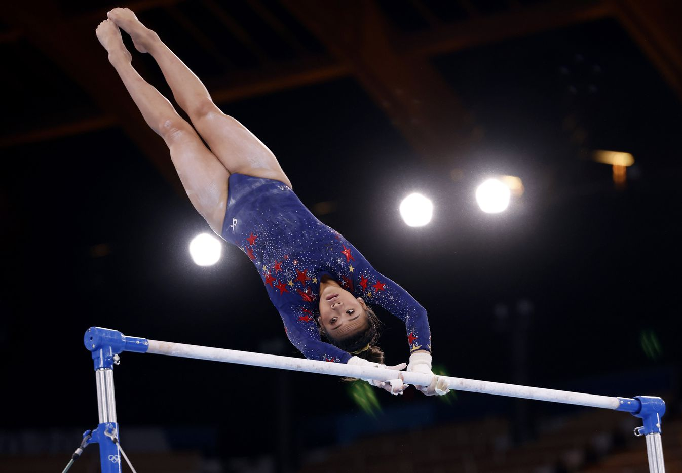 USA's Sunisa Lee competes on the uneven bars in a women's gymnastics event during the postponed 2020 Tokyo Olympics at Ariake Gymnastics Centre on Sunday, July 25, 2021, in Tokyo, Japan. (Vernon Bryant/The Dallas Morning News)