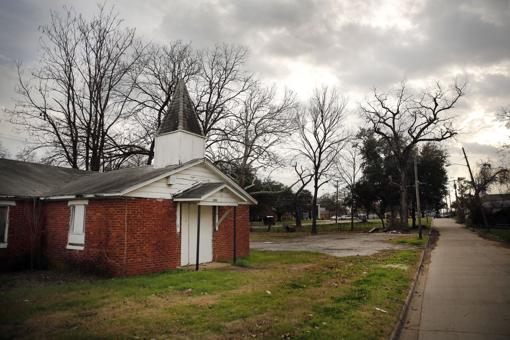 The Dallas Central Appraisal District said this church on Wahoo Street  belongs to the Zan Wesley Holmes Jr. Community Outreach Center. It has been boarded up for years.