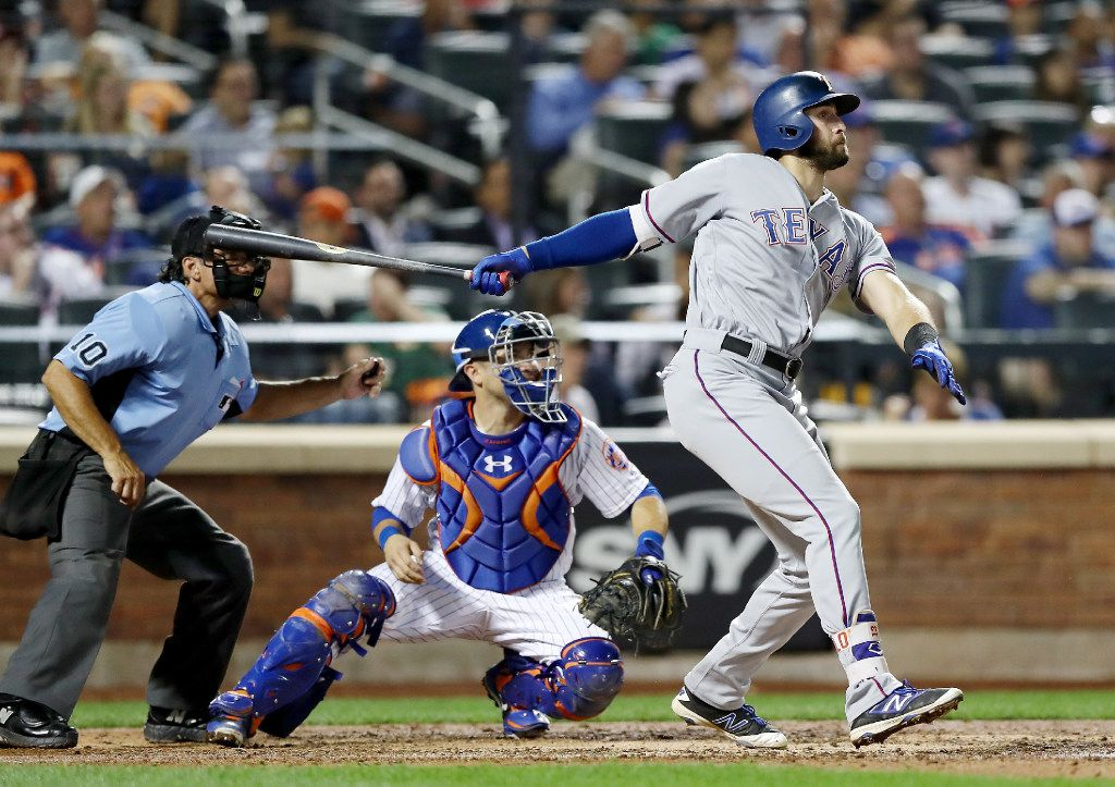 NEW YORK, NY - AUGUST 08:  Joey Gallo #13 of the Texas Rangers hits an RBI double as Travis d'Arnaud #18 of the New York Mets defends in the sixth inning during interleague play on August 8, 2017 at Citi Field in the Flushing neighborhood of the Queens borough of New York City.  (Photo by Elsa/Getty Images)