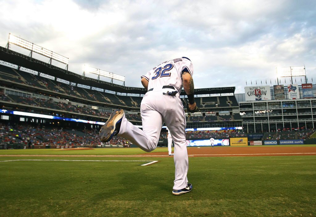 FILE - Josh Hamilton takes the field for a game against the Cleveland Indians at the Ballpark in Arlington on Tuesday, Sept. 13, 2011.   (Tom Fox/The Dallas Morning News)
