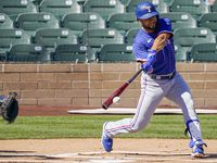 Texas Rangers infielder Isiah Kiner-Falefa connects for a single during the first inning of a spring training game against the Arizona Diamondbacks at Salt River Fields at Talking Stick on Saturday, March 6, 2021, in Scottsdale, Ariz.