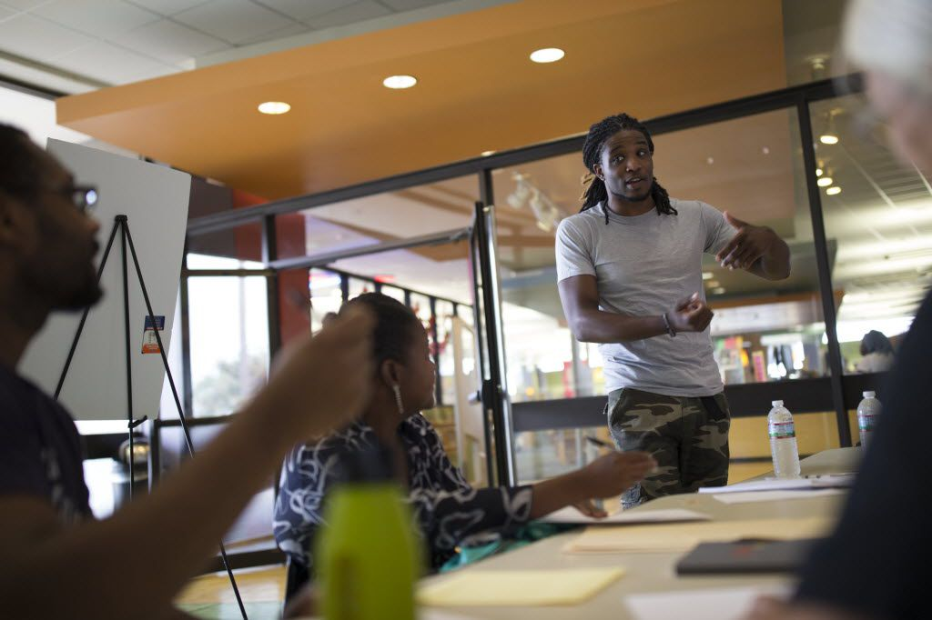 Tro'juan Henderson (right), a spoken word artist and poet, leads an workshop during Make Art with Purpose at Dallas West Branch Library on Aug. 13, 2016 in Dallas. (Ting Shen/The Dallas Morning News)