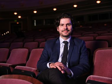 """Colombian composer Victor Agudelo sits for a video shoot and portrait on Oct. 6 at Bass Performance Hall in downtown Fort Worth. The Fort Worth Symphony will premiere his new work """"Algo Va a Suceder"""" or """"Something Is going to happen"""" at Bass Performance Hall on Oct. 8."""