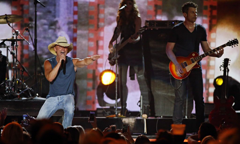 Kenny Chesney performs during the 2015 Academy of Country Music Awards Sunday, April 19, 2015 at AT&T Stadium in Arlington, Texas.