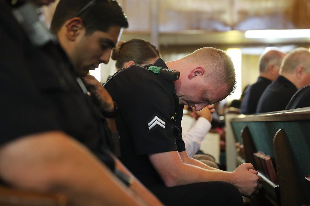 Police officers from departments in and around Dallas prayed at a multicultural vigil on Sunday in Dallas. Cleveland police are increasing security ahead of next week's Republican National Convention.