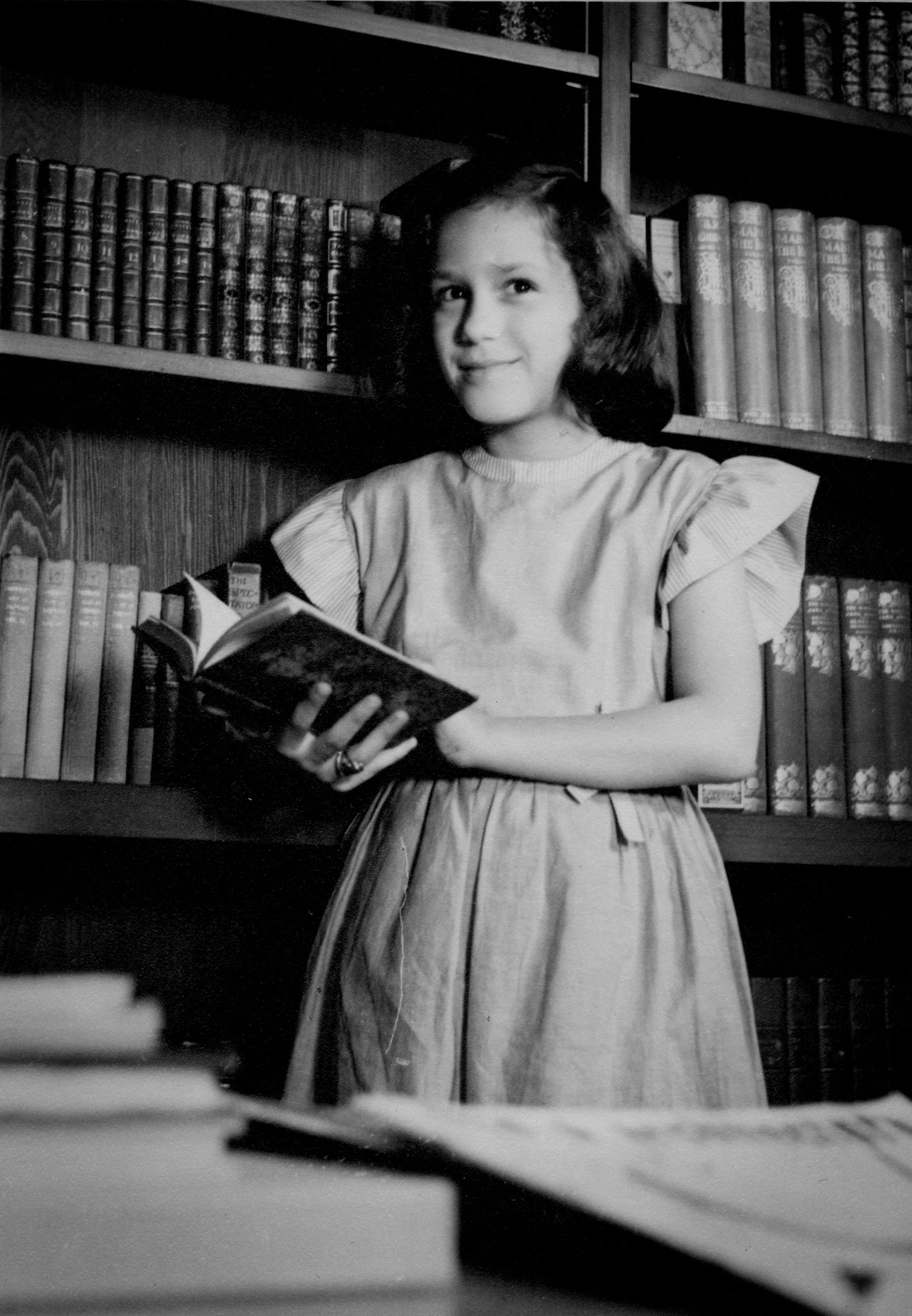 The author, Jerrie Marcus Smith, photographed at 10 years old in her father's library in her childhood home in Dallas. Photograph by Stanley Marcus.