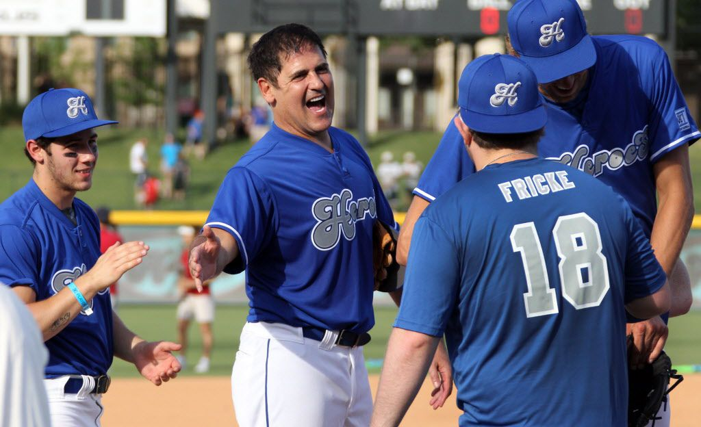 Dallas Mavericks owner Mark Cuban, center, and Nick Jonas  greet Special Olympics all-star softball players before the Annual Heroes Celebrity Baseball Game at Dr Pepper Ballpark in Frisco on Saturday, June 29, 2013.  (Louis DeLuca/Dallas Morning News)