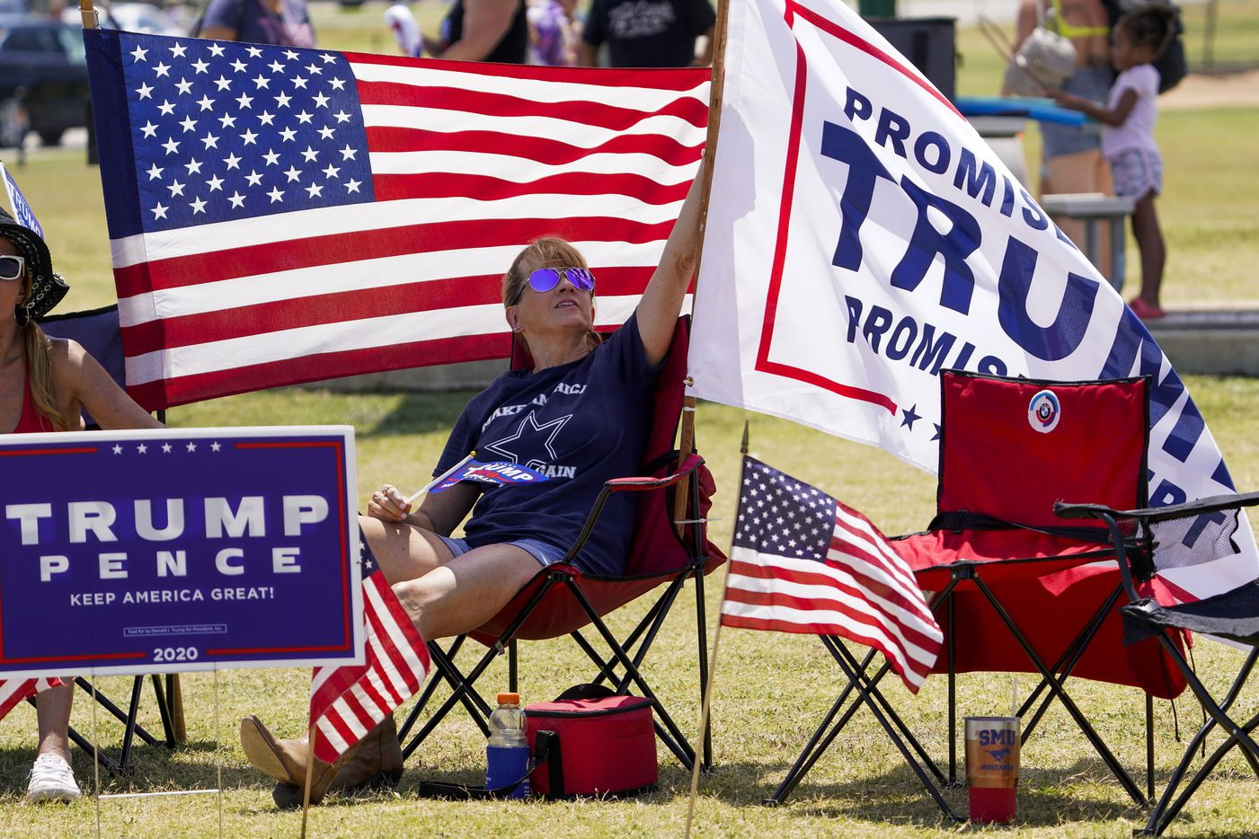 Supporters of President Donald Trump attend a campaign rally and boat parade at Oak Grove Park on Grapevine Lake on Saturday, Aug. 15, 2020.