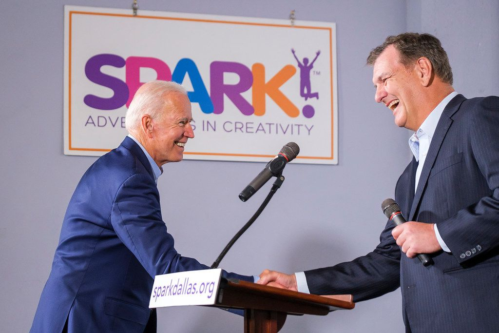 Democratic presidential candidate Joe Biden (left) shakes hands with Dallas Mayor Mike Rawlings as he is introduced to speak to participants in the Dallas Mayor's Intern Fellows Program as during a campaign event at SPARK! on Wednesday, May 29, 2019, in Dallas.