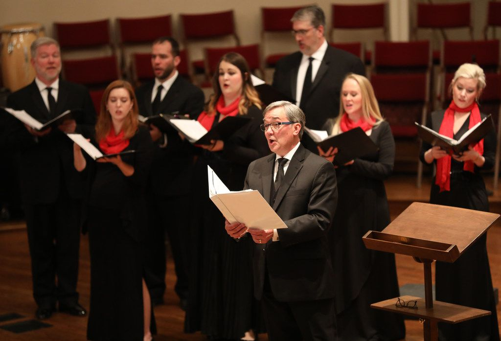 Artistic director Donald Krehbiel (foreground) and the Orpheus Chamber Singers lead the audience in a carol at Custer Road United Methodist Church in Plano on Thursday, Dec. 14, 2017.