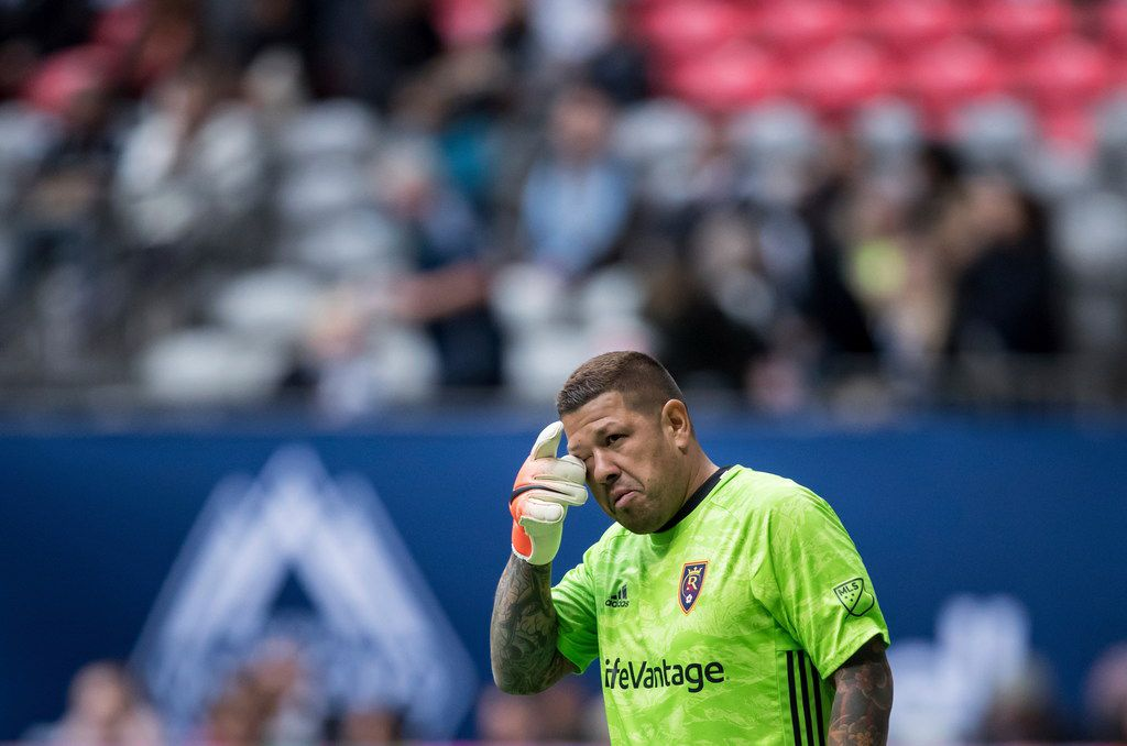 Real Salt Lake goalkeeper Nick Rimando wipes his eye during second-half MLS soccer action against the Vancouver Whitecaps in Vancouver, British Columbia, Sunday, Oct. 6, 2019. (Darryl Dyck/The Canadian Press via AP)