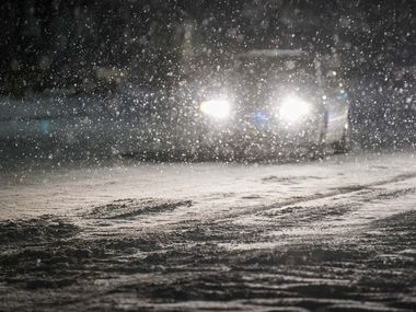 Cars move slowly through falling snow on Plano Road near Renner Road as a second winter storm brought more snow and continued freezing temperatures to North Texas on Tuesday night, Feb. 16, 2021, in Richardson. (Smiley N. Pool/The Dallas Morning News)