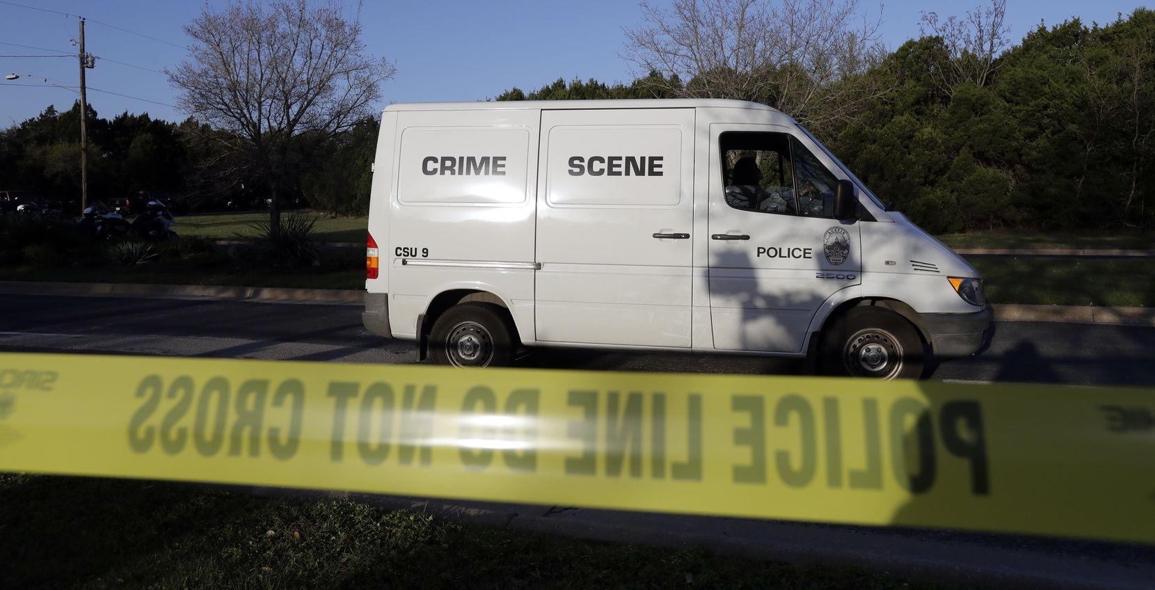 A police crime scene van arrives near the site of Sunday's deadly explosion.